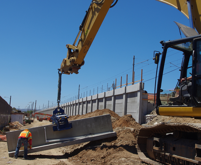 Wall in foreground w/ base held by barrier clamp